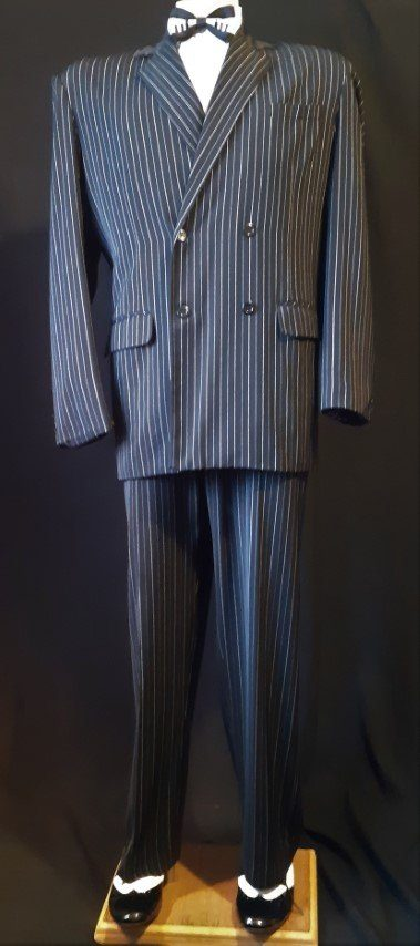 "Black pinstriped double breasted suit, polyester, with braces, size 2Xl, 44"" pant."