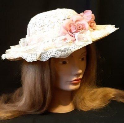 Straw hat covered in lace and imatation flowers, size 58cm.