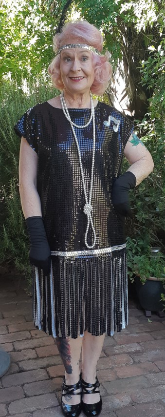 1920's inspired 'All that Jazz' costume, black sequined with gloves and feather headband, size 14-16