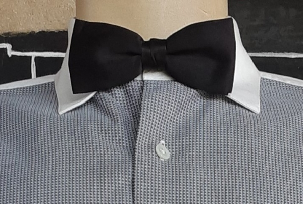 Bow tie, black polyester, on metal clip.