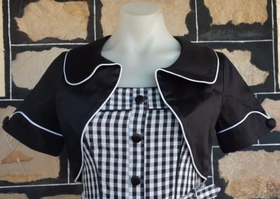 "Black Cropped Bolero with piping trim, by ""Banned Apparel', cotton/elastane, size 10"