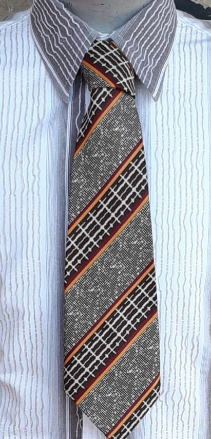 1970's Super Wide tie, tweed abstract print, autumnal colours, polyester by 'Flying High'
