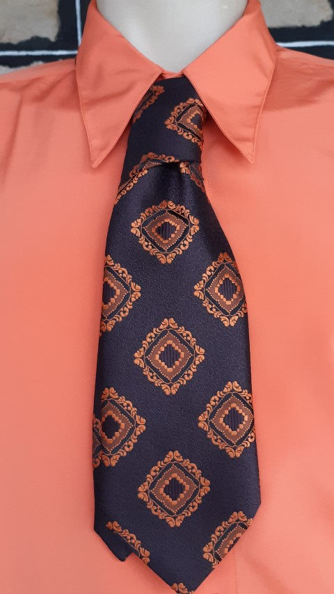 1970's Wide tie, brown/ orange print, polyester, by 'Rodney for Connoisseur'